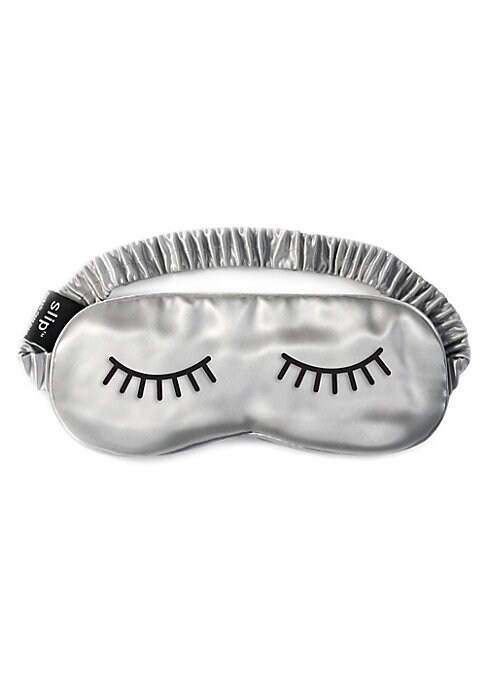 Image of Give the gift of luxurious beauty sleep with slip's Lashes Sleep Mask. Crafted from 100% mulberry silk, this chic piece feels incredibly soft against your skin while blocking out light so you can sleep more soundly. This incredibly gentle material causes