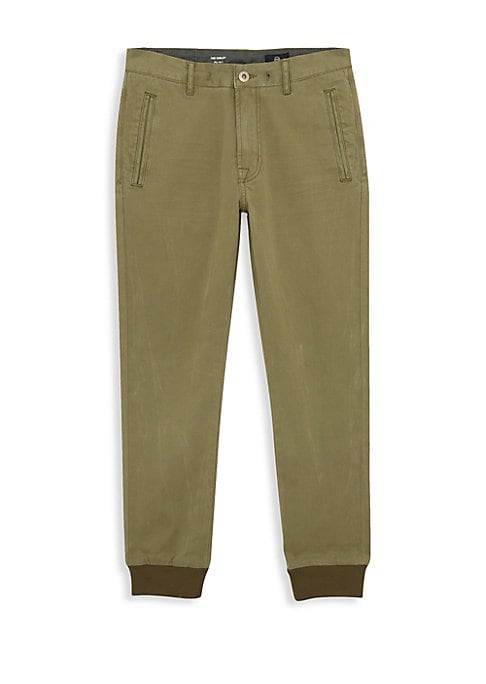 Image of Classic chino pants updated with modern jogger look. Belt loops. Zip fly with button close. Side welt pockets. Back flap pockets. Rib-knit cuffs. Cotton/spandex. Machine wash. Imported.