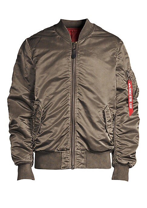 Image of EXCLUSIVELY AT SAKS FIFTH AVENUE. A battlewashed version Alpha's classic MA-1 jacket with a satin sheen. Baseball collar. Long sleeves. Front zip close. Two exterior flap pockets. Utility pocket on sleeve. Reversible alpha logo on zig-zag zipper extension