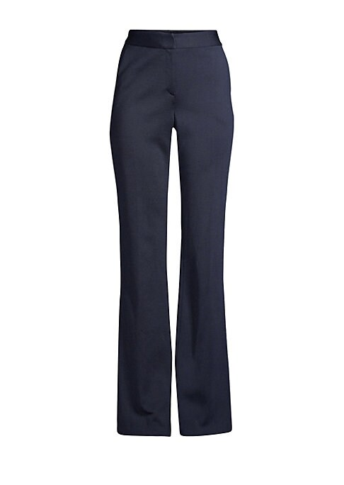 Image of Sleek flare pants are crafted in minimalist aesthetic. Versatile in its subdued aesthetic, this piece can be paired with a crisp white top. Banded waist. Zip fly with hook closure. Side slash pockets. Woven finish. Viscose/wool. Dry clean. Imported of Ita