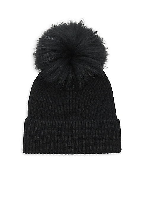 Image of The beanie goes luxe, crafted out of cashmere and finished with a large fox fur pom pom. Ribbed finish. Cashmere. Fur type: Dyed fox. Fur origin: Finland. Dry clean by fur specialist. Imported.