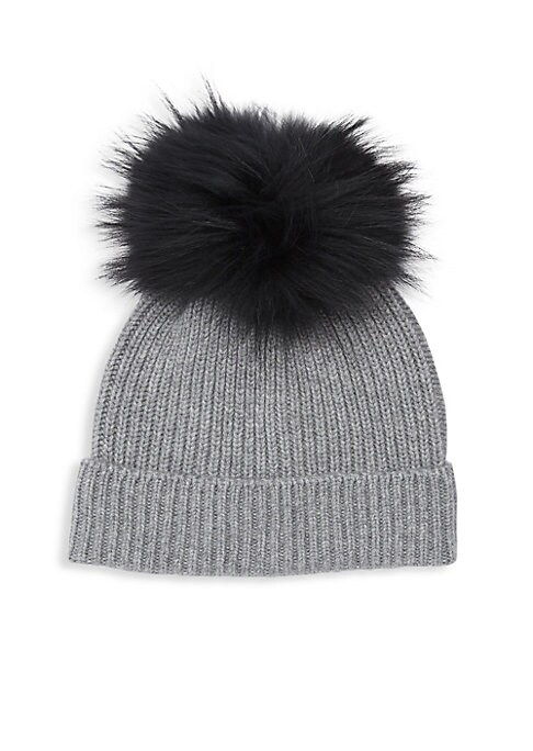 "Image of Cozy cashmere rib-knit beanie hat with dyed fox fur pom. Folded hem. Large fox fur pom. Fur type: Dyed silver fox fur. Fur origin: Finland. Cashmere. Professional fur clean only. Imported. SIZE.9"" wide."