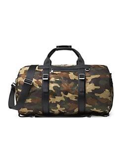 6ef9c12d8599 Michael Kors. Kent Camo Backpack Duffle Bag