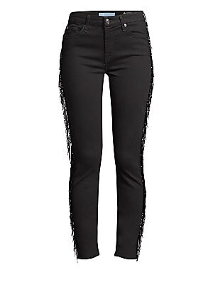 Image of A long beaded fringe accents the side of each leg, adding sparkle and movement to these skinny jeans. Belt loops Zip fly with button closure Five-pocket style Side beaded fringe Logo patch Cotton/lyocell/polyester Dry clean Imported SIZE & FIT Skinny leg