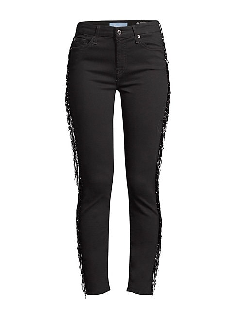 Image of A long beaded fringe accents the side of each leg, adding sparkle and movement to these skinny jeans. Belt loops. Zip fly with button closure. Five-pocket style. Side beaded fringe. Logo patch. Cotton/lyocell/polyester. Dry clean. Imported. SIZE & FIT. Sk