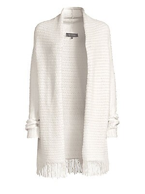 Image of The look of rustic elegance can be achieved in the form of this knit cardigan. Billowy in silhouette and embellished with a fringed hem, this piece lends cozy effects by the fireplace. Shawl collar Long drop shoulder sleeves Open front Fringe hem Wool/sil