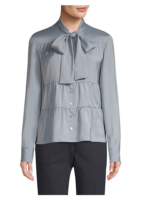 Image of Cut from stretch silk-blend fabric, blouse features gathered tiers and dramatic tie neck. Stand collar with self tie neck. Long sleeves. Button front. Button cuffs. Tiered details. Viscose/silk/elastane. Dry clean. Made in USA of imported fabric. SIZE & F