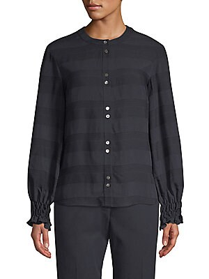 "Image of Flirty smocked cuffs and jacquard detailing highlight this casual button-up. Roundneck Long sleeves Smocked cuffs Button front Back box pleat Viscose Dry clean Made in USA SIZE & FIT Relaxed fit About 25.5"" from shoulder to hem Model shown is 5'10 (177cm)"