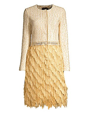 Image of Redefine the ensemble with this glamorous tiered fringe jacket. Crafted with a tweed top, it lends the illusion of an effortlessly sophisticated jacket and skirt ensemble. Roundneck Long sleeves Concealed button front Crochet waist Tiered fringed skirt Si
