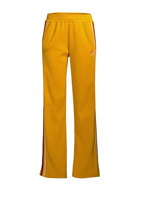 """Image of Fashion forward take on the track pant with a classic side stripe. Elasticized waist. Side seam pockets. Polyester/cotton. Machine wash. Made in Canada. SIZE & FIT. Rise, about 31.5"""".Leg-opening, about 18"""".Inseam, about 32"""".Model shown is 5'10"""" (177cm) we"""
