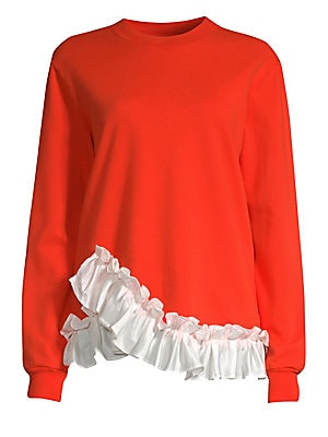 """Image of Casual cotton sweatshirt elevated with a glossy ruffle trim. Roundneck Long sleeves Pullover style Rib-knit trim Asymmetric ruffle hem Cotton Contrast: Polyester Hand wash Made in USA SIZE & FIT About 25.5"""" from shoulder to hem Model shown is 5'10 (177cm)"""