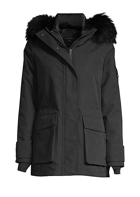 Image of Cozy coat with fox fur-trimmed hood and storm cuffs with thumb holes. Fur-trimmed hood. Long sleeves. Grip-tape cuffs. Concealed zip closure. Inside drawstring waist. Lined. Cotton/polyamide. Fur type: Dyed silver fox. Fur origin: Finland. Dry clean by fu