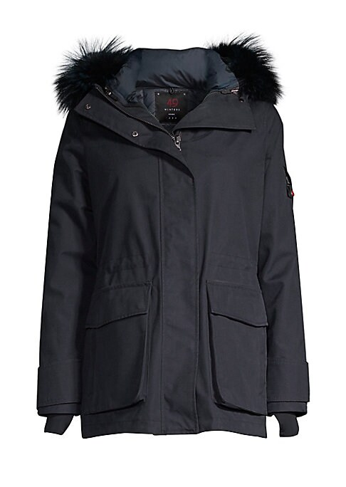 Image of Plush fox fur trim adds chic defnition to a cozy parka designed with a removable hood. Removable hood with fox fur trim. Stand collar. Long sleeves. Grip-tape strap cuffs. Thumb holes. Zip and snap front. Sleeve zip pocket. Elasticized waist. Waist flap p