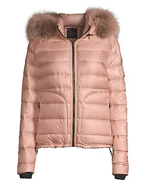 Image of Contemporary quilted puffer boasts luscious fox fur trim hood. Attached hood with fox fur trim Stand collar Long sleeves Zip closure Waist zip pockets Polyamide Fur type: Dyed silver fox Fur origin: Finland Dry clean by fur specialist Imported SIZE & FIT
