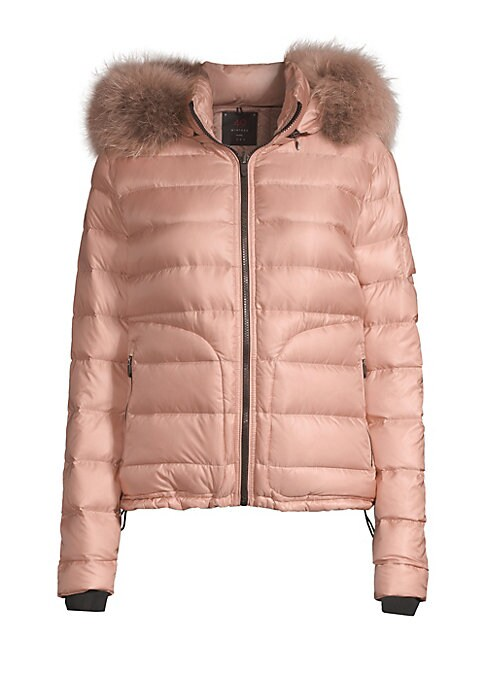 Image of Contemporary quilted puffer boasts luscious fox fur trim hood. Attached hood with fox fur trim. Stand collar. Long sleeves. Zip closure. Waist zip pockets. Polyamide. Fur type: Dyed silver fox. Fur origin: Finland. Dry clean by fur specialist. Imported. S