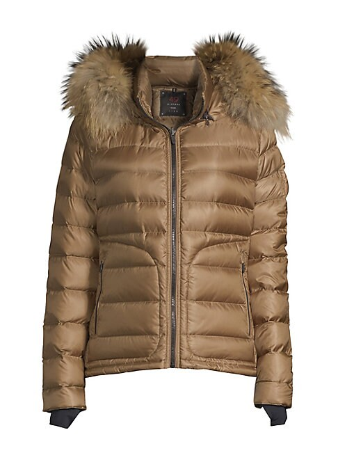Image of Contemporary quilted puffer jacket boasts luscious fox fur trim hood. Attached hood with fox fur trim. Stand collar. Long sleeves. Zip closure. Waist zip pockets. Polyamide. Fur type: Dyed fox. Fur origin: Finland. Dry clean by fur specialist. Imported. S