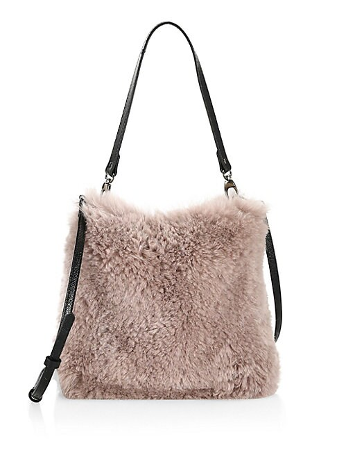 Image of EXCLUSIVELY AT SAKS FIFTH AVENUE. Plush shearling exterior is accented by leather straps on this hobo bag. Removable top handle. Adjustable, removable crossbody strap. Top zip closure. Silvertone hardware. Two interior slip pockets. Fully lined. Shearling