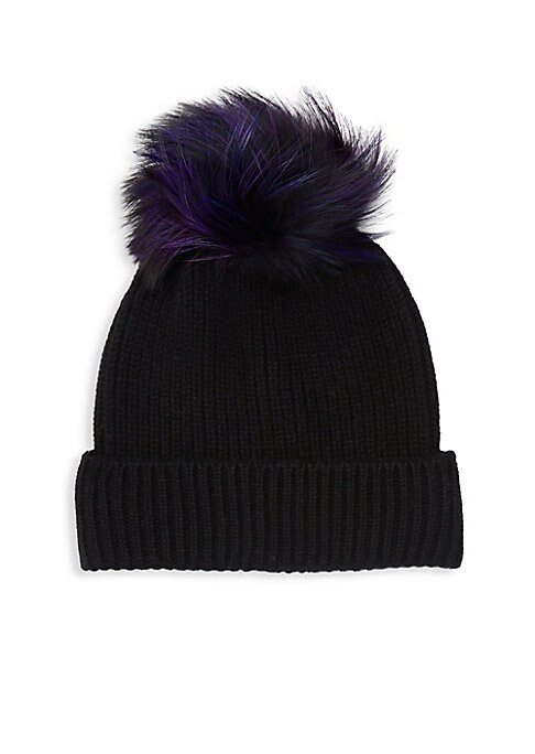 Image of Cashmere beanie boasting a rib-knit construction and finished with a fluffy fur pom-pom. Cashmere. Fur type: Dyed silver fox fur. Fur origin: Finland. Dry clean by fur specialist. Imported.