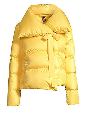 Image of Boasting an exaggerated collar with a tie detail and a cropped length, this is a fresh and feminine take on the cozy puffer jacket. Spread collar with self-tie Long sleeves Concealed snap button front Waist zippered welt pockets Lined Polyester Fill: Duck