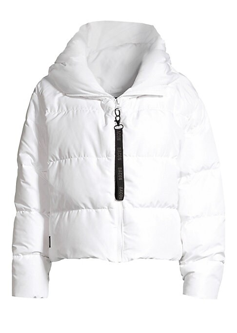 """Image of On-trend chunky puffer coat with a logo zip front. Puffed spread collar. Long sleeves. Front zip close with logo pull. Concealed side zip pockets. Lined. Polyester. Fill: Duck down. Dry clean. Imported. SIZE & FIT. Puffer silhouette. About 22"""" from should"""