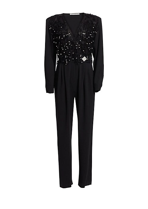 Image of A strong shoulder paired with a pleated, tapered leg lends this stretch wool jumpsuit a modernized 80s aesthetic. Sequined fringes decorate the bodice, set off by crystal-studded buttons at the waist and cuffs for a look that's festive without being overb
