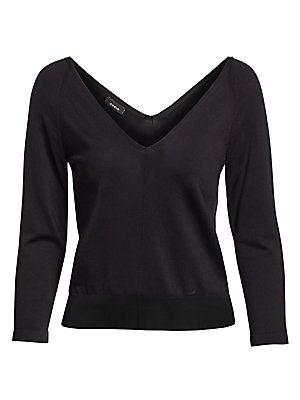 Image of A classic wardrobe staple, this cropped V-neck is crafted from knit stretch silk and flaunts a thick banded waist that flatteringly gathers for a casual look that can be easily dressed up. V-neck Long sleeves Pullover style Front tonal seaming Banded wais