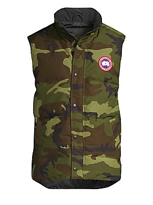 Image of A quilted duck down vest in a camouflage print can be layered under a winter coat for added warmth when the temperature drops. Stand collar Sleeveless Snap front Waist welt pockets Curved hem Lined Poly/cotton Fill: Duck down/feather Machine wash Made in