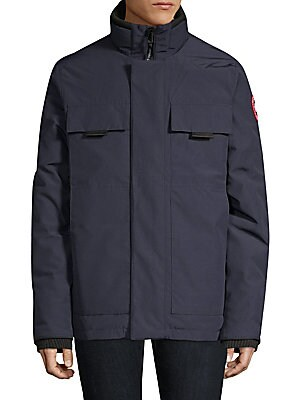 Image of A sleek down jacket with minimal styling for a refined cold-weather look. Stand collar Long sleeves with rib-knit cuffs Zip front with concealed snap placket Chest patch flap pockets Waist slash patch pockets Lined Poly/cotton Fill: Duck down/feather Dry