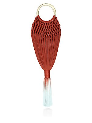 Image of 60's inspired crocheted bag with bottom tassel. Double top ring handles Open top Acrylic/polyester Imported SIZE 6W x 17H x 2.5D. Handbags - Contemporary Handbags. Cult Gaia. Color: Terracotta.