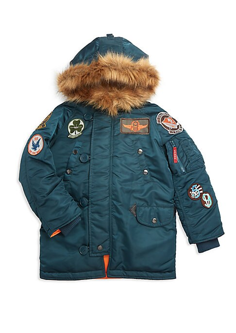 Image of Cozy parka lined with removable faux fur trim and decorated with military-inspired patches. Attached hood. Long sleeves. Zip front with button placket. Shoulder zip pocket. Rib-knit cuffs. Chest snap welt pockets. Waist snap flap pockets. Fur type: Faux.