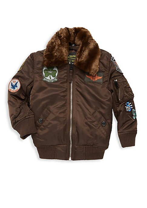 Image of Cozy bomber jacket trimmed with faux fur and decorated with military-inspired patches. Point collar. Long sleeves. Zip front. Shoulder zip pocket. Rib-knit trim. Waist snap welt pockets. Fur type: Faux. Nylon. Dry clean. Imported.