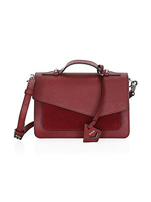 "Image of Crafted from saffiano leather, this stylish bag boasts a top handle and removable crossbody strap. Magnetic flap closure Brushed goldtone hardware Back slip pocket Interior zip pocket Interior slip pockets Leather Imported SIZE Top handle, 1.5"" drop Adjus"