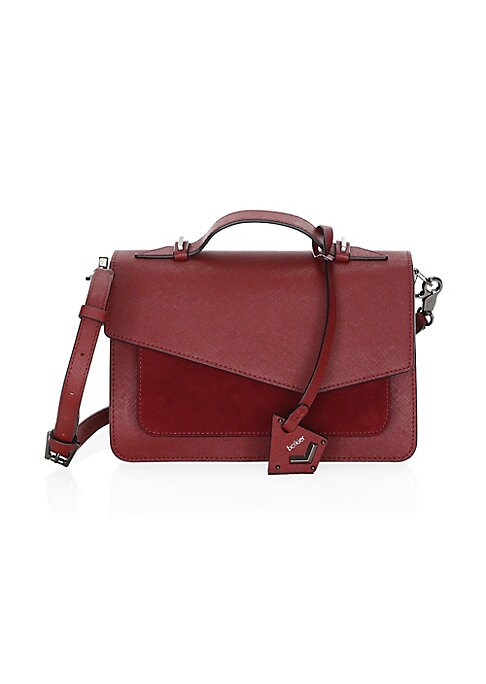 "Image of Crafted from saffiano leather, this stylish bag boasts a top handle and removable crossbody strap. Magnetic flap closure. Brushed goldtone hardware. Back slip pocket. Interior zip pocket. Interior slip pockets. Leather. Imported. SIZE. Top handle, 1.5"" dr"