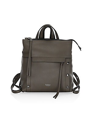 Image of A pebbled leather construction and studded details lend street style edge to this backpack. Top zip closure Silvertone hardware One front zip pocket One back zip pocket One interior zip pocket One interior slip pocket Two interior credit card slots Leathe