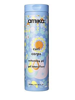 Image of WHAT IT IS Amika Curl Corps Enhancing Gel is a weather-proofing, curl-boosting gel that gives bouncy shape without the crunch factor. A weather-proofing, curl-boosting gel that gives bouncy shape without the crunch factor. Free of MIT/MCI, formaldehydes,