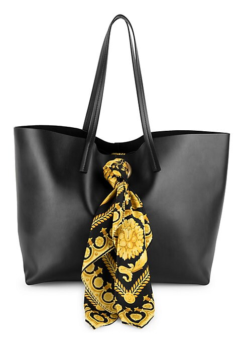 "Image of Supple leather tote flaunts an ornate chiffon scarf with brand's iconic chain imagery. Double top handles. Open top. One interior attached pouch. Fully lined. Leather. Made in Italy. SIZE.13.98""W x 11.8""H x 7.87""D."