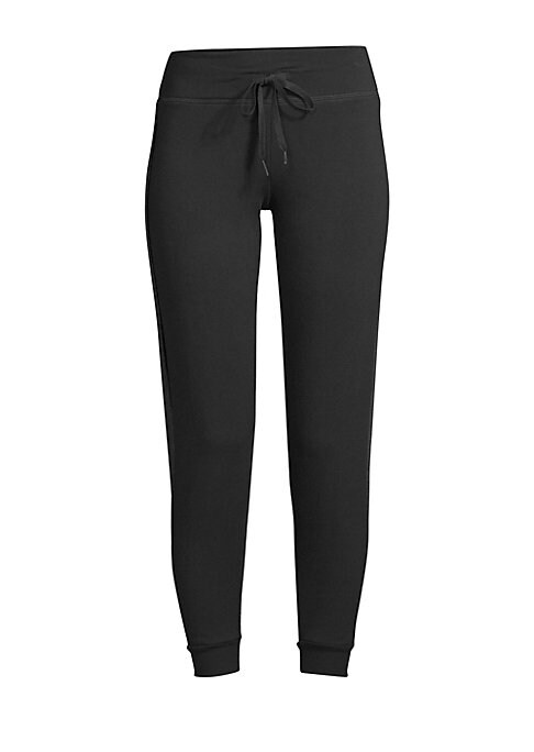 """Image of A cropped length and slightly relaxed fit enhances these tuxedo-inspired joggers with side stripe details. Drawstring waistband. Pull-on style. Ribbed cuffs. Modal/polyester/spandex. Machine wash. Made in USA. SIZE & FIT. Rise, about 8"""".Inseam, about 28""""."""