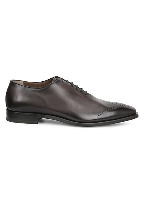 Image of Handsome leather oxfords with an understated brogue detailed toe. Leather upper. Almond toe. Leather lining. Padded insole. Leather sole. Made in Italy.