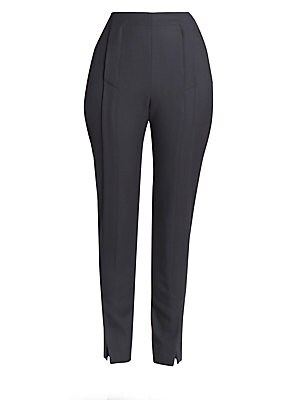 Image of The silhouette of these wool trousers falls somewhere between a jodhpur and a sailor pant. Standout details include the front flap closure, which segues into foldover slits at the ankle for a striking yet simple look. Dual concealed zip closure Side slash
