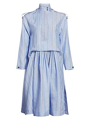 Image of A striped fabrication plucked from the world of men's shirting patterns this midi-length shirtdress. Epaulettes, ruching at the waist and a high-low hemline all serve to elevate the silhouette. Stand collar Long sleeves Concealed front zip placket Epaulet