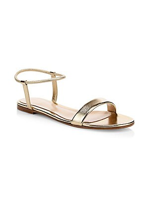 Image of Sleek metallic leather sandals with a chic ankle strap design. Leather upper Open toe Slip-on ankle strap Leather lining and sole Made in Italy. Women's Shoes - Gianvito Rossi Wmn Shoes > Saks Fifth Avenue. Gianvito Rossi. Color: Gold. Size: 37.5 (7.5).