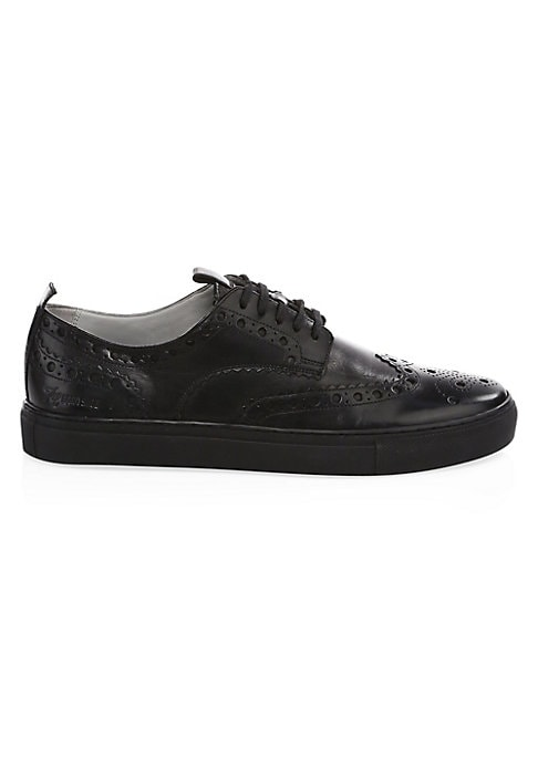 Image of Sneaker-style shoe with brogue perforation. Leather upper. Lace-up closure. Rubber sole. Imported. SIZE. Heel, 30mm.