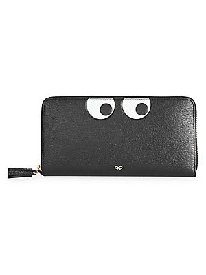 """Image of Embossed eyes lend a quirky pop art vibe to this sleek leather wallet. Zip around closure Goldtone hardware Two interior bill compartments One interior zip divider Six interior credit card slots Lined Leather Imported SIZE 7.48""""W x 4.13""""H x 1""""D. Handbags"""