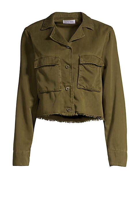 """Image of Cropped utility jacket enhanced with a frayed hem. Notch lapels. Long sleeves. Button front. Two chest flap pockets. Tencel/cotton. Dry clean. Made in USA. SIZE & FIT. About 20"""" from shoulder to hem. Model shown is 5'10"""" (177cm) wearing US size Small."""