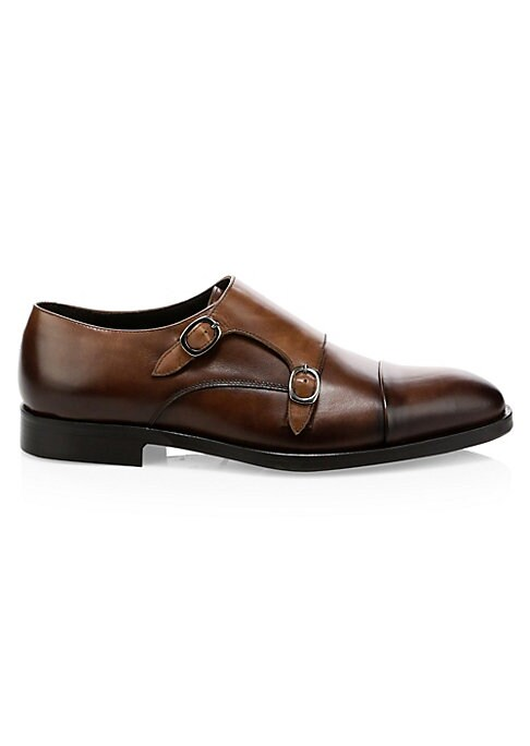 Image of Classic Derby style shoes with double monk strap buckle and cap toe. Stacked heel. Leather upper. Almond cap toe. Double monk strap buckle closure. Padded insole. Rubber sole. Made in Italy.