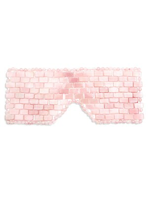 Image of WHAT IT IS This intricately woven, handmade rose quartz eye mask designed by Angela Caglia is the first rose quartz eye mask of its kind. Known for its calming and soothing love energy, rose quartz can help promote a loving sense of well-being. The coolne
