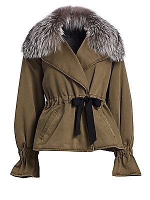 "Image of 90s parka gets a feminine rework with fox fur collar, flared cuffs and wrap waist Fox fur collar Long sleeves Self-tie closure Two hand welt pockets Gathered cuffs/waist Cotton Fur type: Dyed fox Fur origin: China Dry clean Imported SIZE & FIT About 27"" f"