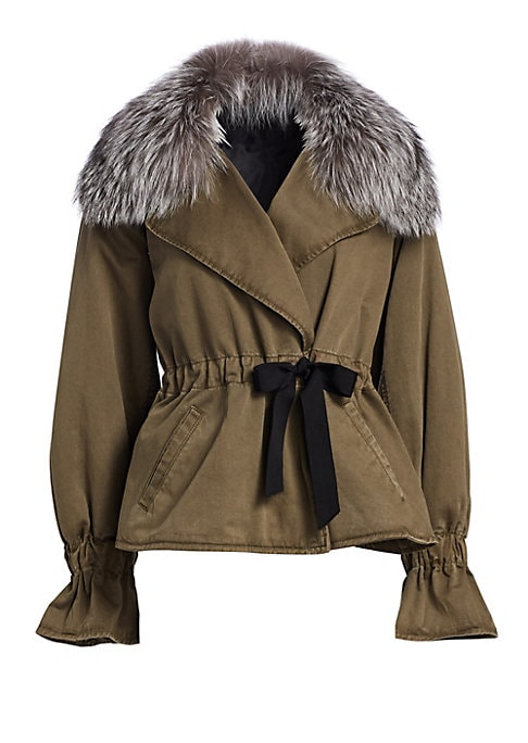 Image of 90s parka gets a feminine rework with fox fur collar, flared cuffs and wrap waist. Fox fur collar. Long sleeves. Self-tie closure. Two hand welt pockets. Gathered cuffs/waist. Cotton. Fur type: Dyed fox. Fur origin: China. Dry clean. Imported. SIZE & FIT.