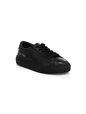 Image of Minimalist leather sneakers with embossed numerical accents are the epitome of fine craftsmanship. Leather upper Round toe Lace-up vamp Leather lining Rubber sole Made in Italy. Children's Wear - Children's Shoes > Saks Fifth Avenue. COMMON PROJECTS. Colo