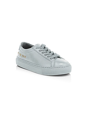 Image of Cool low-top sneakers with serial number detail at the heel. Leather upper Textile lining Padded insole Rubber sole Made in Italy. Children's Wear - Children's Shoes > Saks Fifth Avenue. COMMON PROJECTS. Color: Grey. Size: 27 EU/ 10 US (Toddler).